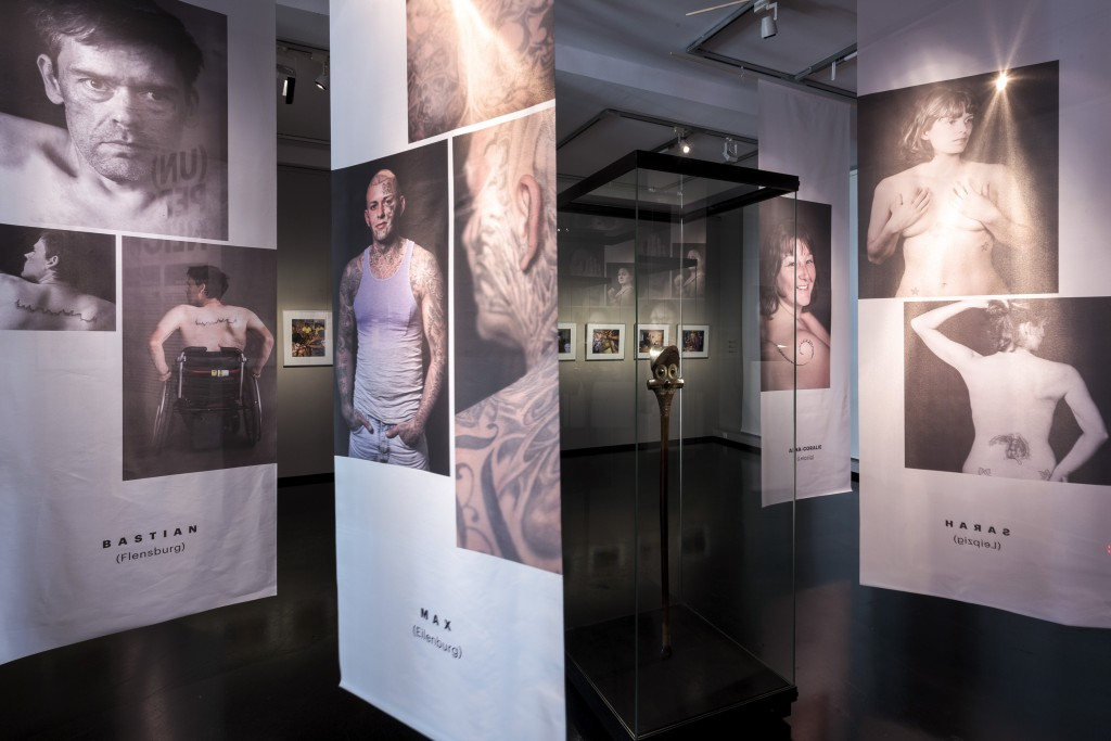 Nick-Putzmann-Grassi-Invites-Tattoo-Piercing-08